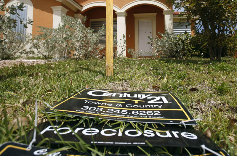 FILE - In this  March 24, 2009 file photo, a sign lies on the ground in front of a foreclosed home in Homestead, Fla. Officials in 49 states have launched a joint investigation into allegations that mortgage companies mishandled documents and broke laws in foreclosing on hundreds of thousands of homeowners. (AP Photo/J Pat Carter, File)