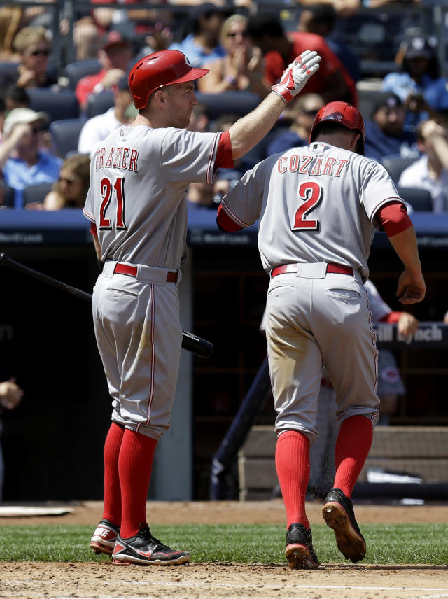 Cincinnati Reds' Zack Cozart, right, celebrates with Todd Frazier after scoring during the fifth inning of a baseball game against the New York Yankees at Yankee Stadium, Sunday, July 20, 2014, in New York. (AP Photo/Seth Wenig)