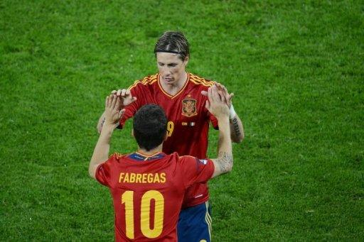 Spanish forward Fernando Torres is congratulated by Spanish midfielder Cesc Fabregas after scoring during the Euro 2012 championships football match Spain vs Republic of Ireland at the Gdansk Arena. A double by Torres inspired defending champions Spain to a 4-0 thrashing of Ireland