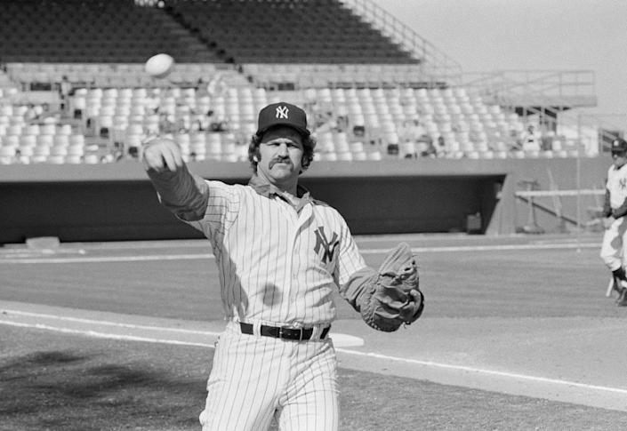 """New York Yankees catcher Thurman Munson, shown in training camp in 1978, was killed in a plane crash on Aug. 2, 1979 while he was practicing takeoffs and landings near his home in Ohio. <span class=""""copyright"""">(Robert H. Houston / Associated Press)</span>"""