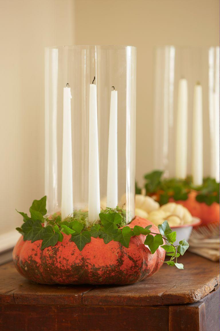 """<p>Bring pumpkins to life with a collection of white taper candles and trailing ivy.</p><p><a class=""""link rapid-noclick-resp"""" href=""""https://go.redirectingat.com?id=74968X1596630&url=https%3A%2F%2Fwww.potterybarn.com%2Fproducts%2Fpb-boxed-taper-candles%2F&sref=https%3A%2F%2Fwww.goodhousekeeping.com%2Fholidays%2Fhalloween-ideas%2Fg33437890%2Fhalloween-table-decorations-centerpieces%2F"""" rel=""""nofollow noopener"""" target=""""_blank"""" data-ylk=""""slk:SHOP TAPER CANDLES"""">SHOP TAPER CANDLES</a></p>"""