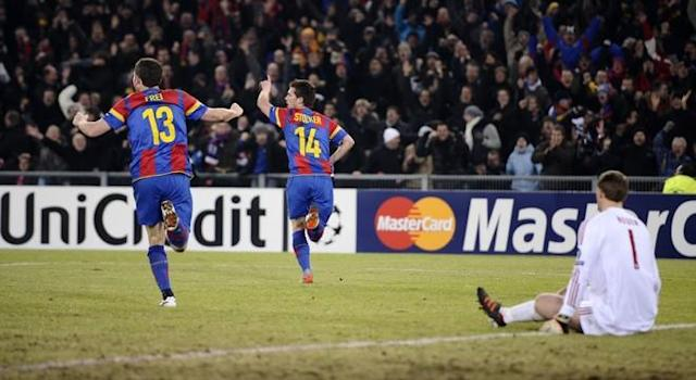 FC Basel's midfielder Valentin Stocker (C) celebrates with team-mate forward Alexander Frei (L) after he scored against Bayern Munich's goalkeeper Manuel Neuer (R) on February 22, 2012, during their UEFA Champions League round of sixteen first leg football match between FC Basel versus Bayern Munich at the St. Jakob stadium in Basel. AFP PHOTO / FABRICE COFFRINI