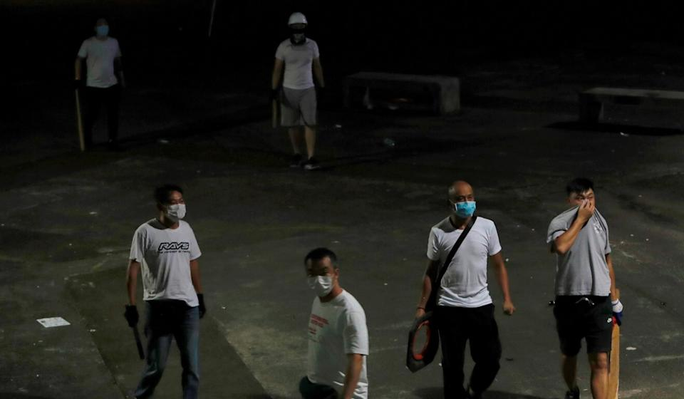 A group of men in white T-shirts indiscriminately attacked passengers and protesters returning from a mass rally at the Yuen Long MTR station on July 21, 2019. Photo: Reuters