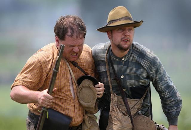 GETTYSBURG, PA - JUNE 30: Confederate Civil War re-enactors flee the battlefield following Pickett's Charge on the last day of a Battle of Gettysburg re-enactment on June 30, 2013 in Gettysburg, Pennsylvania. Some 8,000 re-enactors from the Blue Gray Alliance participated in the event, marking the 150th anniversary of the July 1-3, 1863 Battle of Gettysburg. Confederate General Robert E. Lee's Army of Northern Virginia was routed during the doomed frontal assault, considered the turning point in the Civil War and a watershed moment in U.S. history. Union and Confederate armies suffered a combined total of up to 51,000 casualties over three days, the highest number of any battle in the four-year war. Pickett's charge was named for the Confederate Maj. General George Pickett, whose division of rebel troops was annhilated in the attack. (Photo by John Moore/Getty Images)