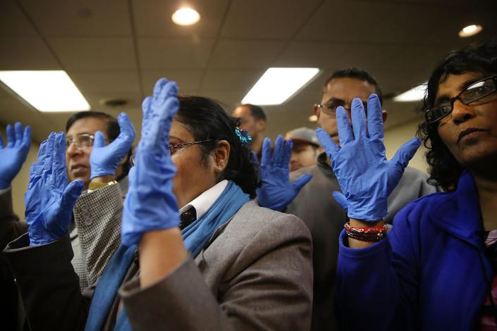 Workers with the union 32BJ, many of them airline cabin cleaners, terminal cleaners and wheelchair attendants, participate in a class on how to better protect themselves from infectious diseases in the wake of increased concerns around the Ebola virus on October 9, 2014 in New York City.