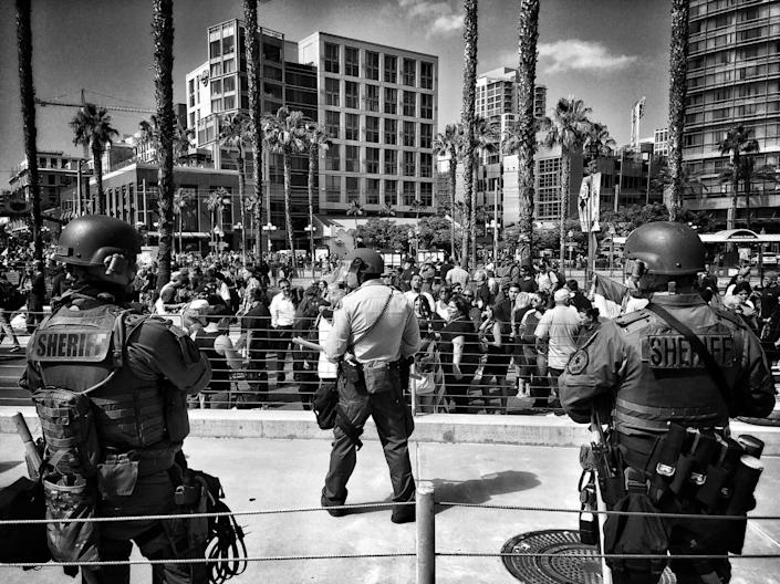 <p>San Diego law enforcement in riot gear stand off with protesters outside a Trump rally on May 27 in San Diego, Calif. (Photo: Holly Bailey/Yahoo News) </p>