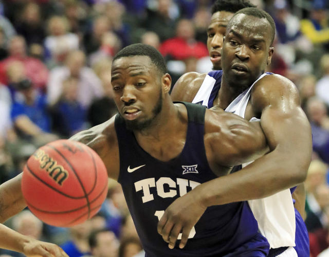 Kansas State forward Makol Mawien, right, reaches around TCU forward JD Miller, left, during the first half of an NCAA college basketball game in the quarterfinals of the Big 12 conference tournament in Kansas City, Mo., Thursday, March 14, 2019. (AP Photo/Orlin Wagner)