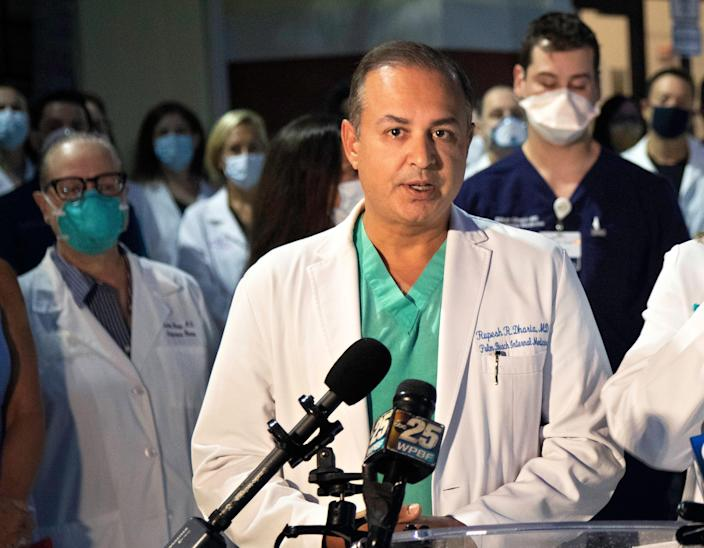 Dr. Rupesh Dharia speaks as a group of physicians gathered in Palm Beach Gardens Monday morning, August 23, 2021 to speak in support of masks and vaccines and address questions about COVID and our community. The entire physician staff of Palm Beach Gardens Medical Center was invited, as well as doctors from other area hospitals.
