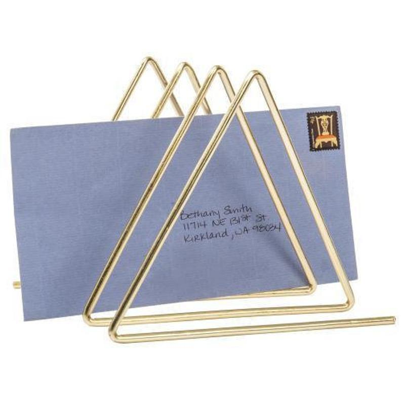 "<h2>MyGiftUS Triangular Brass Tone Wire Magazine Organizer</h2><br>Despite its small stature, this geometric holder can store your mail, magazines, papers, and books.<br><br><em>Shop</em> <a href=""https://www.etsy.com/shop/MyGiftUS?ref=simple-shop-header-name&listing_id=854810147"" rel=""nofollow noopener"" target=""_blank"" data-ylk=""slk:MyGiftUS"" class=""link rapid-noclick-resp""><strong><em>MyGiftUS</em></strong></a><br><br><strong>MyGiftUS</strong> Triangular Brass Tone Wire Magazine Organizer, $, available at <a href=""https://go.skimresources.com/?id=30283X879131&url=https%3A%2F%2Fwww.etsy.com%2Flisting%2F854810147%2Ftriangular-brass-tone-wire-magazine"" rel=""nofollow noopener"" target=""_blank"" data-ylk=""slk:Etsy"" class=""link rapid-noclick-resp"">Etsy</a>"