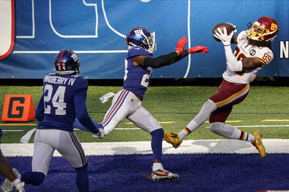 Washington Football Team wide receiver Cam Sims (89) catches a pass for a touchdown in front of New York Giants' Logan Ryan (23) during the second half of an NFL football game Sunday, Oct. 18, 2020, in East Rutherford, N.J. (AP Photo/Bill Kostroun)