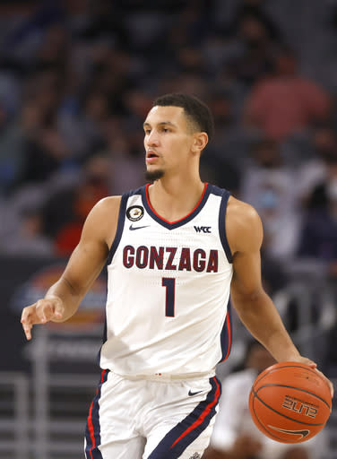 Gonzaga guard Jalen Suggs (1) brings the ball up court against Virginia during the second half of an NCAA college basketball game, Saturday, Dec. 26, 2020, in Fort Worth, Texas. (AP Photo/Ron Jenkins)