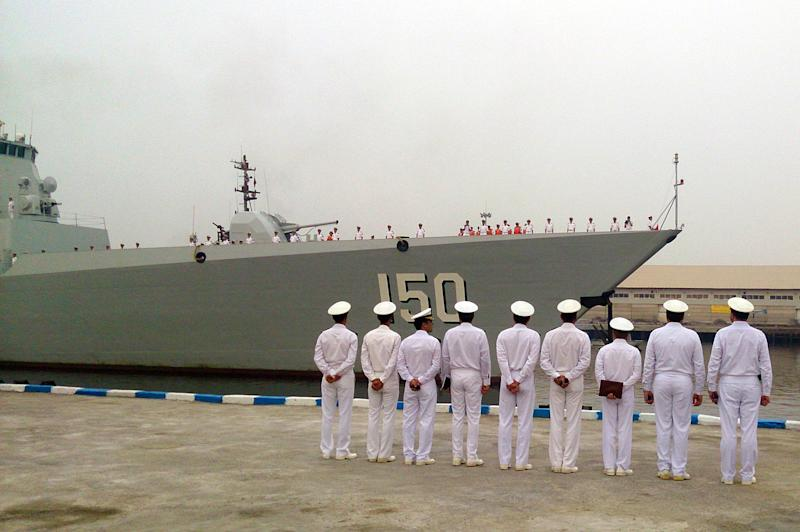 A photo provided by the Iranian news agency IRNA shows navy officers lining up to welcome a Chinese destroyer at the port of Bandar Abbas on September 20, 2014 (AFP Photo/Nader Nasseri)