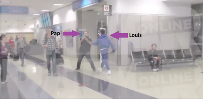Louis approaches the pap and tries to grab his camera [RADAR ONLINE]