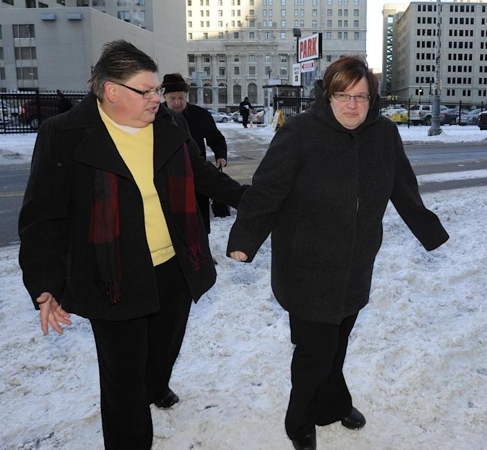 Jayne Rowse and April DeBoer walk outside Federal Courthouse before a trial that could overturn Michigan's ban on gay marriage in Detroit on Monday, March 3, 2014 in Detroit. Lisa Brown of Oakland County, the elected clerk of a Detroit-area county says she'll follow the orders of a judge when it comes to same-sex marriage, not Michigan's attorney general. Brown was asked about an email last fall from the attorney general's office, which warned county clerks not to issue marriage licenses to same-sex couples, even if a judge threw out the ban. Michigan voters banned gay marriage in 2004. In a lawsuit, Detroit-area nurses April DeBoer and Jayne Rowse say that violates the U.S. Constitution. (AP Photo/Detroit News, David Coates) DETROIT FREE PRESS OUT; HUFFINGTON POST OUT