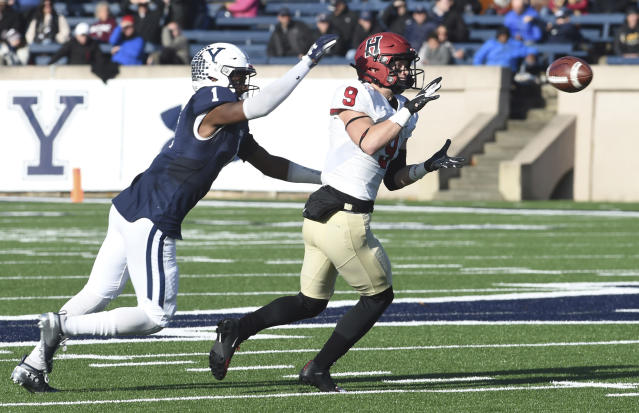 Harvard's Cody Chrest makes a reception as Yale's Malcolm Dixon defends during the first half during an NCAA college football game, Saturday, Nov. 23, 2019, in New Haven, Conn. (Arnold Gold/New Haven Register via AP)