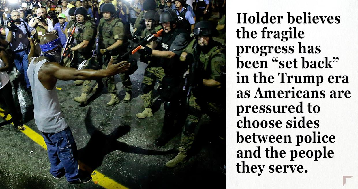 Police arrest a man as they disperse a protest in Ferguson. (Photo: Charlie Riedel/AP)