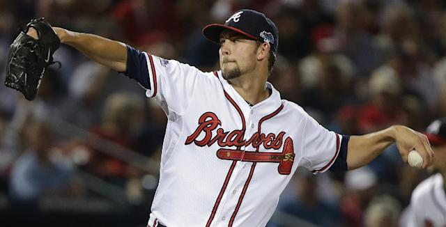 Atlanta Braves starting pitcher Mike Minor works in the seventh inning against the Los Angeles Dodgers during Game 2 of the National League division series on Friday, Oct. 4, 2013, in Atlanta. (AP Photo/John Bazemore)