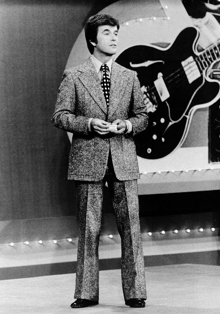 """FILE - In this 1973 file photo released by ABC, Dick Clark presents the Rock and Roll Year_ a musical portrait of the 1950s and 1960s on the ABC television network in a series of five specials. Clark, the television host who helped bring rock `n' roll into the mainstream on """"American Bandstand,"""" died Wednesday, April 18, 2012 of a heart attack. He was 82. (AP Photo/ABC, File)"""