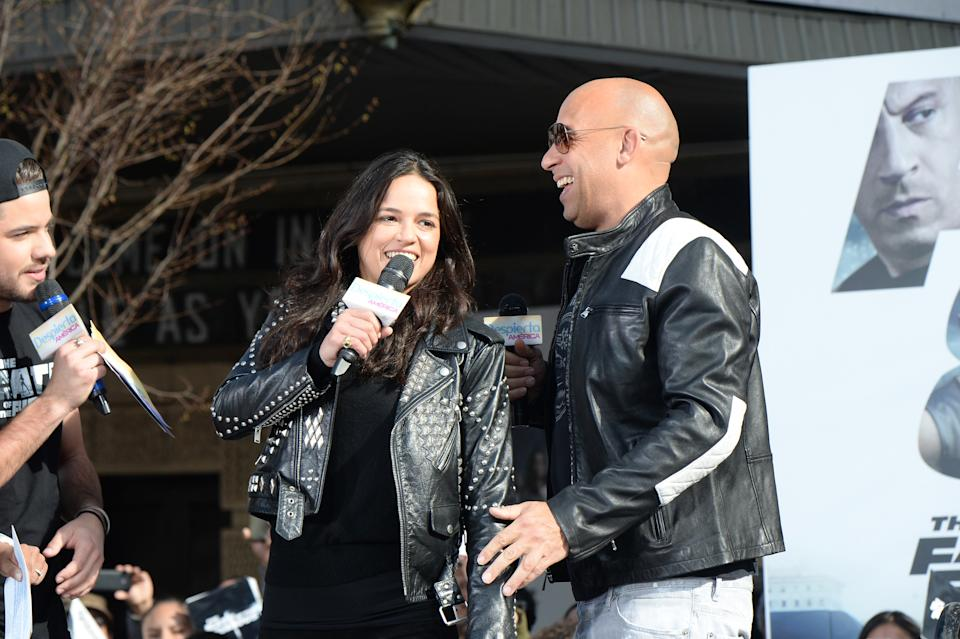 """Michelle Rodriguez and Vin Diesel visit Washington Heights on behalf of """"The Fate Of The Furious"""" on April 11, 2017. (Photo by Kevin Mazur/Getty Images for Universal Pictures)"""