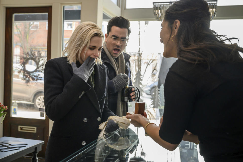 "This image released by Hulu shows Kristen Stewart, left, and Dan Levy in a scene from ""Happiest Season."" (Jojo Whilden/Hulu via AP)"