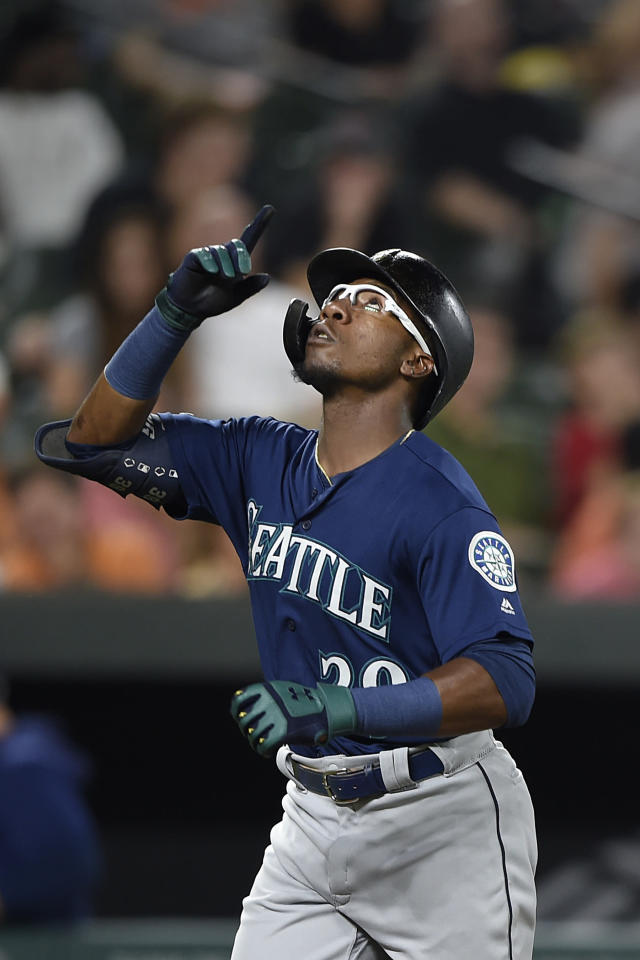 Seattle Mariner' Shed Long reacts after hitting a solo home run against the Baltimore Orioles in the third inning of a baseball game, Saturday, Sept. 21, 2019, in Baltimore. (AP Photo/Gail Burton)