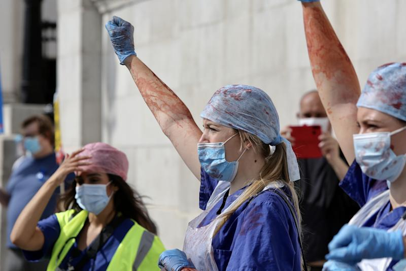 LONDON, UNITED KINGDOM- SEPTEMBER 12: NHS workers attend the 'March for Pay' Demonstration in London, United Kingdom on September 12, 2020. (Photo by Hasan Esen/Anadolu Agency via Getty Images)