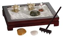 <p>Get this <span>Mini Zen Garden </span> ($25) for a coworker's desk.</p>