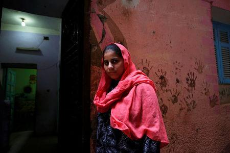 Nada Salah, 14, looks on outside her home in Alwasata village of Assiut Governorate, south of Cairo, Egypt, February 8, 2018. REUTERS/Hayam Adel/Files