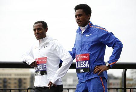 Kenenisa Bekele (L) and Feyisa Lilesa (R) of Ethiopia ahead of the 2017 Virgin Money London Marathon
