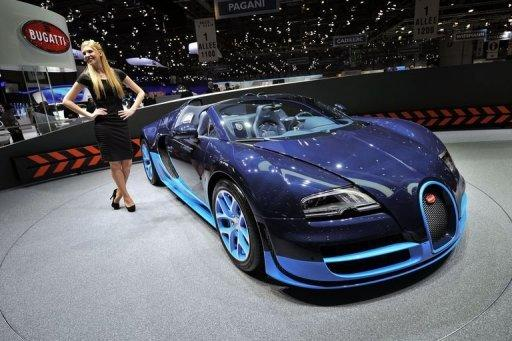 A Bugatti Veyron Grand Sport Vitesse is displayed at the car maker's booth ahead of the Geneva Motor Show. Sports cars, reputed for being energy guzzlers, are now trying to boost their green credentials as they seek to attract environmentally conscious consumers and meet new climate standards