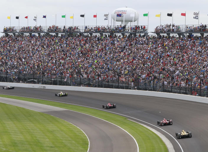 """FILE - Fans watch the running of the Indianapolis 500 auto race in the first turn at Indianapolis Motor Speedway in Indianapolis, in this Sunday, May 28, 2017, file photo. The Indianapolis 500 will be the largest sporting event since the start of the pandemic with 135,000 spectators permitted to attend """"The Greatest Spectacle in Racing"""" next month. Indianapolis Motor Speedway said Wednesday, April 21, 2021, it worked with the Marion County Public Health Department to determine 40% of venue capacity can attend the May 30 race. (AP Photo/R Brent Smith, File)"""