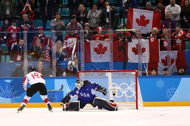 <p>Madeline Rooney #35 of the United States makes a save against Brianne Jenner #19 of Canada in the overtime penalty-shot shootout during the Women's Gold Medal Game on day thirteen of the PyeongChang 2018 Winter Olympic Games at Gangneung Hockey Centre on February 22, 2018 in Gangneung, South Korea. (Photo by Jamie Squire/Getty Images) </p>