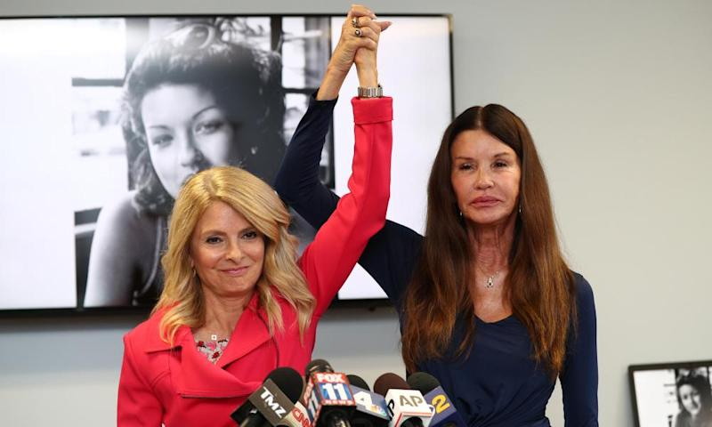 Lisa Bloom and Janice Dickinson announce a settlement in their defamation lawsuit against Bill Cosby in Woodland Hills, California, on 25 July.