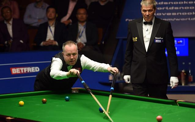 <span>John Higgins won the 29th, 30th and 31st frames to fight back to 15-16</span> <span>Credit: AFP PHOTO/Paul ELLIS </span>