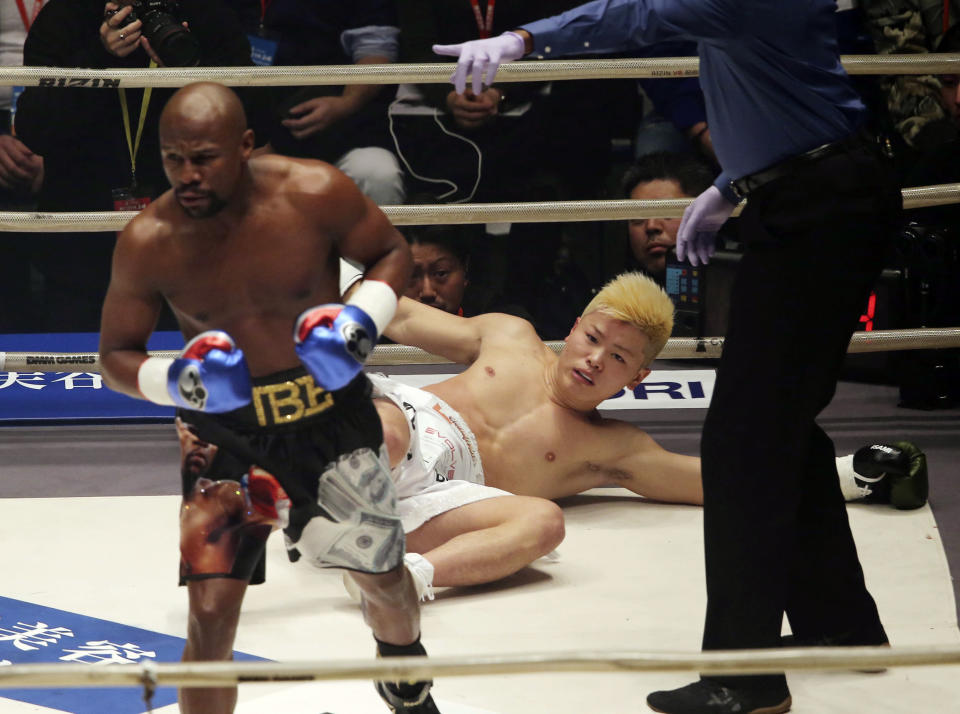 Japanese kickboxer Tenshin Nasukawa lies on the mat after being knocked out by Floyd Mayweather Jr. in a New Year's Eve exhibition in Tokyo. (AP Photo/Koji Sasahara)