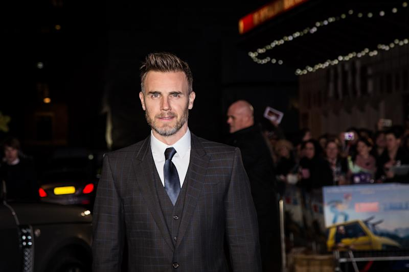 Singer Gary Barlow poses for photographers upon arrival at the premiere of the film 'Eddie the Eagle' in London, Thursday, March 17, 2016. (Photo by Vianney Le Caer/Invision/AP)