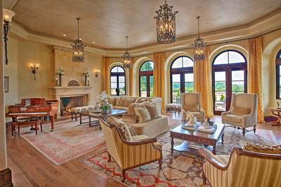 Interior decor emphasizes the Italianate theme, with granite and tumbled marble, custom masonry and stone work, and rustic accents of warm woods and wrought iron complementing the architecture. NewJerseyLuxuryAuction.com.