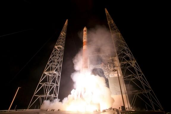 A United Launch Alliance-built Delta IV rocket launches the sixth Wideband Global Satcom (WGS) satellite Aug. 7, 2013 from Space Launch Complex 37B at Cape Canaveral Air Force Station in Florida. The WGS system provides anytime, anywhere commun
