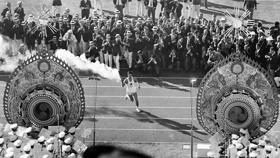 """<span class=""""caption"""">The 1964 Olympics in Tokyo banned all athletes who took part in a counter-competition a year earlier called the Games of the New Emerging Forces, which were dubbed the left-wing Olympics </span> <span class=""""attribution""""><span class=""""source"""">(AP Photo)</span></span>"""