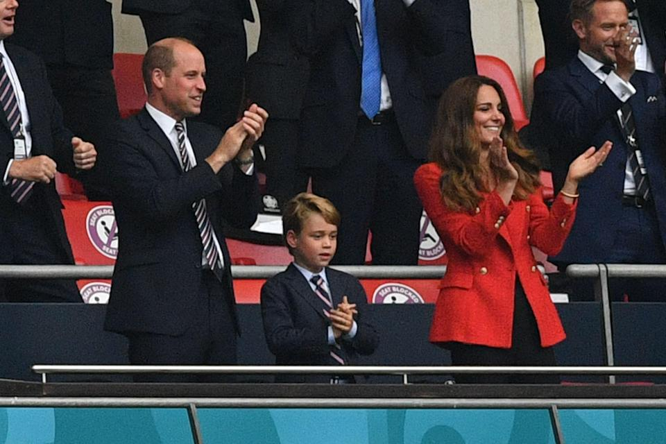 Prince William, Duke of Cambridge, Prince George of Cambridge, and Catherine, Duchess of Cambridge, celebrate the first goal   (POOL/AFP via Getty Images)