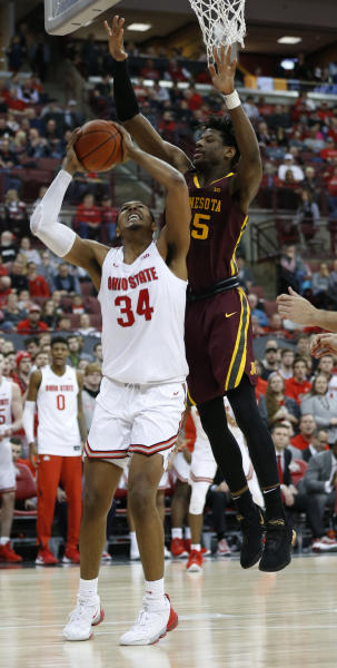 Ohio State's Kaleb Wesson, left, tries to shoot over Minnesota's Daniel Oturu during the second half of an NCAA college basketball game Thursday, Jan. 23, 2020, in Columbus, Ohio.  (AP Photo/Jay LaPrete)