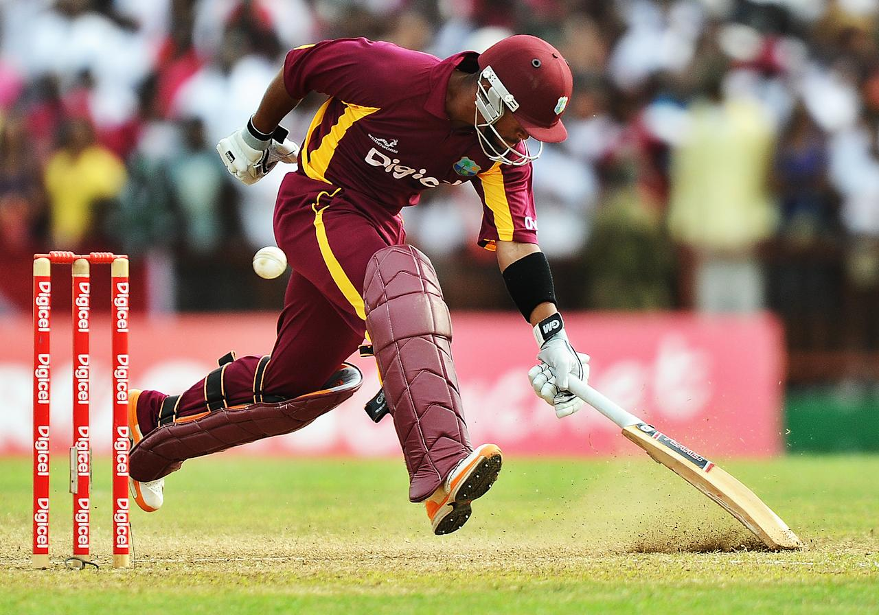 West Indies cricketer Carlton Baugh takes a run during the third-of-five One Day International (ODI) matches between West Indies and Australia at the Arnos Vale Ground in Kingstown on March 20, 2012. Australia have scored 220/10 at the end of their innings. AFP PHOTO/Jewel Samad (Photo credit should read JEWEL SAMAD/AFP/Getty Images)