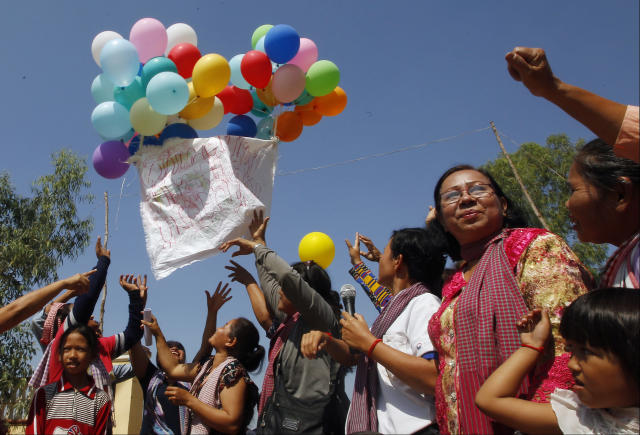 <p>Land activists from the Boeung Chhuk community release balloons to mark International Women's Day on the outskirts of Phnom Penh, Cambodia, Thursday, March 8, 2018. The community took part in the International Women's Day celebration, which coincided with the 10th anniversary of their forced eviction. (Photo: Heng Sinith/AP) </p>