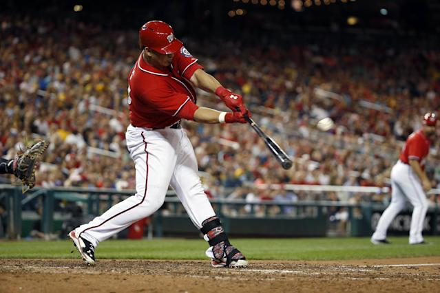 Washington Nationals' Wilson Ramos hits the game-winning ground rule double to score Bryce Harper during the ninth inning of a baseball game against the Pittsburgh Pirates at Nationals Park, Saturday, Aug. 16, 2014, in Washington. The Nationals won 4-3. (AP Photo/Alex Brandon)