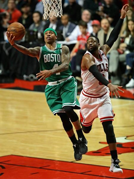 Isaiah Thomas of the Boston Celtics drives to the basket past Dwyane Wade of the Chicago Bulls during Game Three of the Eastern Conference Quarterfinals