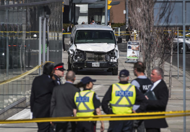 <p>Police are seen near a damaged van after a van mounted a sidewalk crashing into pedestrians in Toronto on Monday, April 23, 2018. (Photo: Aaron Vincent Elkaim/The Canadian Press via AP) </p>