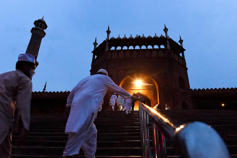 Muslim devotees arrive to offer a special morning prayer to kick off the Eid al-Adha, the feast of sacrifice, at Jama Masjid mosque in New Delhi on August 1, 2020. (Photo by Money SHARMA / AFP) (Photo by MONEY SHARMA/AFP via Getty Images)