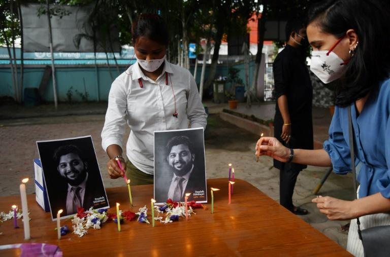 Reporters pay homage to the late Reuters photographer Danish Siddiqui at the Gauhati press club in Guwahati, India