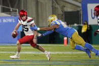 Arizona quarterback Will Plummer, left, is chased by UCLA defensive lineman Datona Jackson during the first half of an NCAA college football game Saturday, Nov. 28, 2020, in Pasadena, Calif. (AP Photo/Marcio Jose Sanchez)