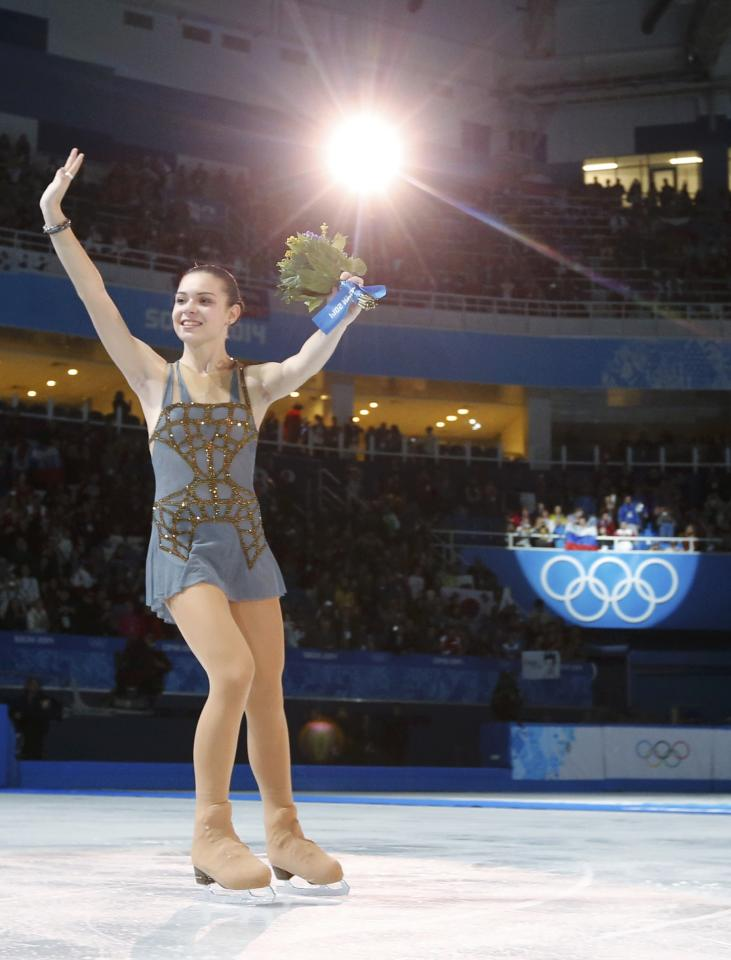 Russia's Adelina Sotnikova celebrates at the end of the Figure Skating Women's free skating Program at the Sochi 2014 Winter Olympics, February 20, 2014. REUTERS/Alexander Demianchuk (RUSSIA - Tags: OLYMPICS SPORT FIGURE SKATING)